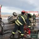 Firefighters preparing equipment.