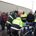 EMS & firefighters get patient on a stretcher.