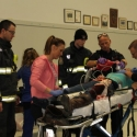 Claresholm General Hospital staff get the report & begin to work on patient.
